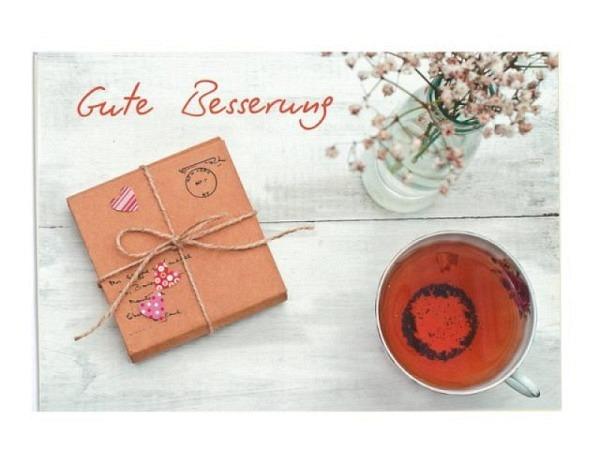 Genesungskarte Hartung braunes Paket und Tasse Tee
